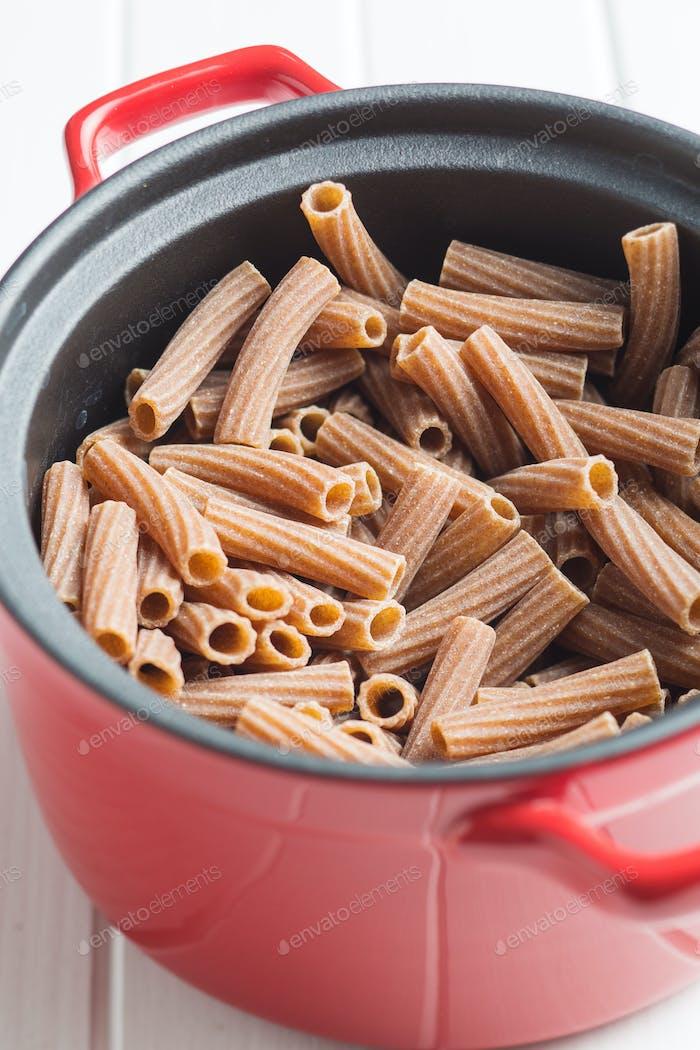 Dried rigatoni pasta.