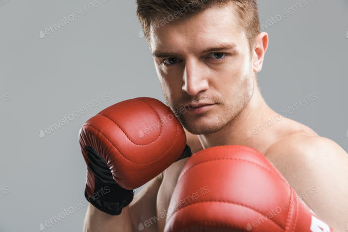 Close up portrait of a concentrated shirtless sportsman