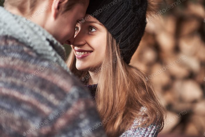 Waist up portrait of carefree young man and woman embracing and smiling