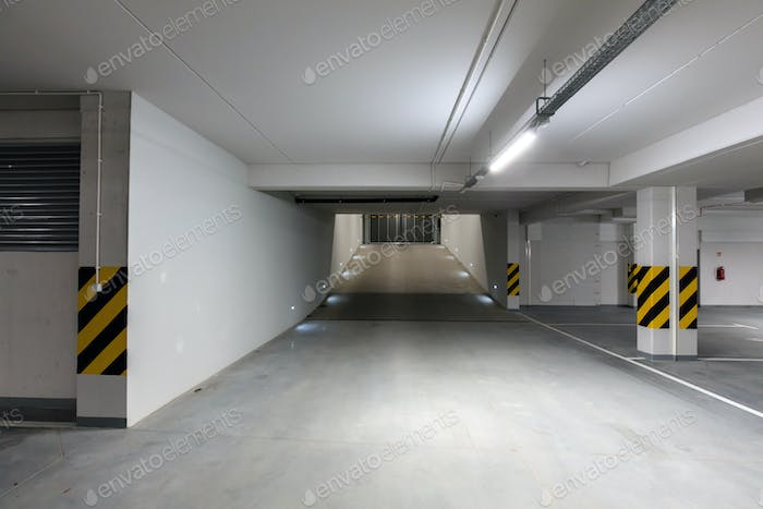 Underground empty parking garage. Gate and gateway