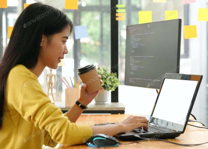 Young professional woman uses laptop for work and online meetings,She works from home.