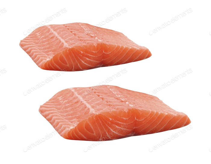 Raw salmon fillets isolated on white background
