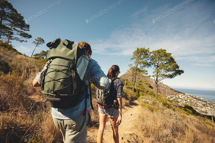 Young couple hiking in mountain