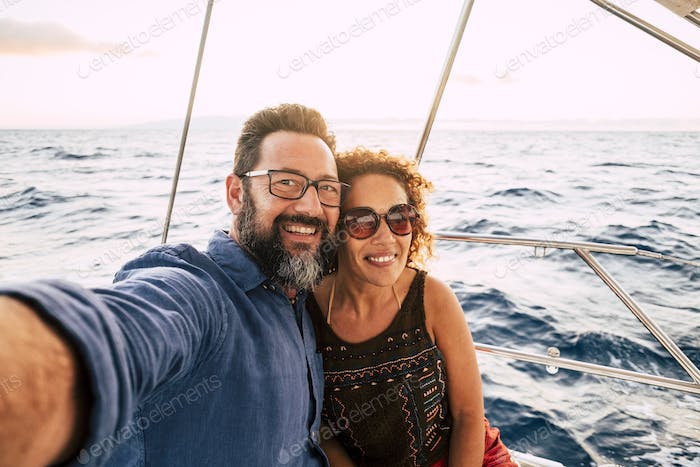 Cheerful people happy adult caucasian couple take selfie picture and enjoy together summer holiday