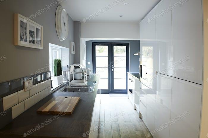 Kitchen in a refurbished house, looking towards back door