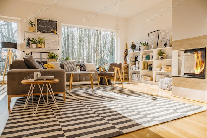 Nordic style living room interior with striped carpet, corner co Foto von  bialasiewicz auf Envato Elements