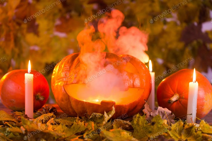 Jack-o-Lantern halloween pumpkin with mist pouring from it's mouth