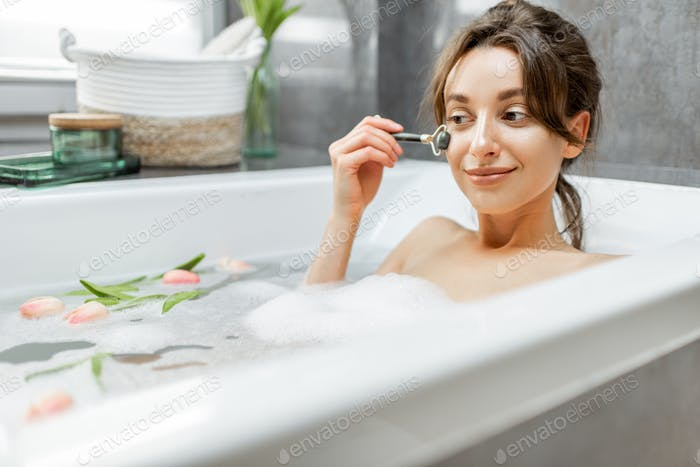 Relaxed woman taking a bath