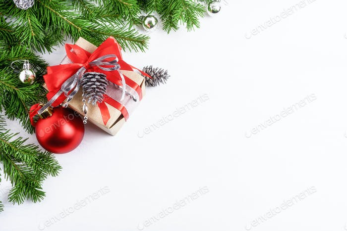 Christmas decorated gift box and silver pine cones, copy space