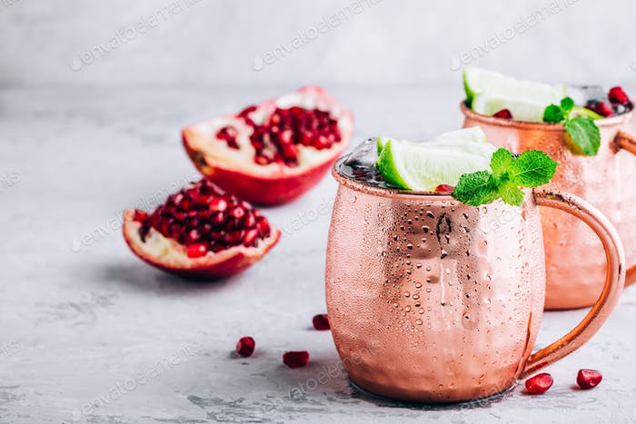 Iced Cold Moscow Mule cocktail with lime and pomegranate