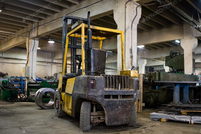 forklift parked inside an industrial hall