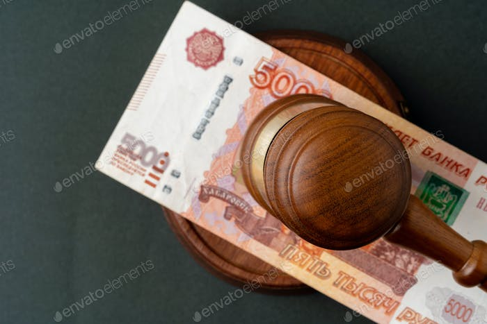 Russian Rubles notes with judge mallet. Corruption concept