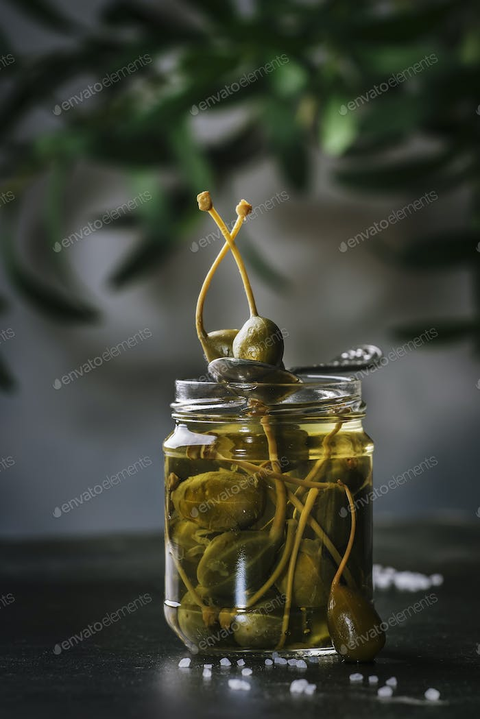 Marinated or pickled canned capers fruit close up