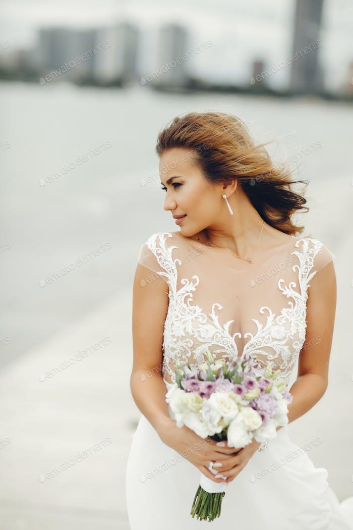 Elegant bride near water