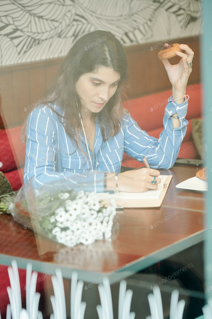 Creative woman writing down thoughts