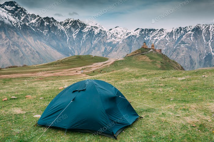 Kazbegi, Georgia. Tent Near Gergeti Trinity Church Or Tsminda Sa