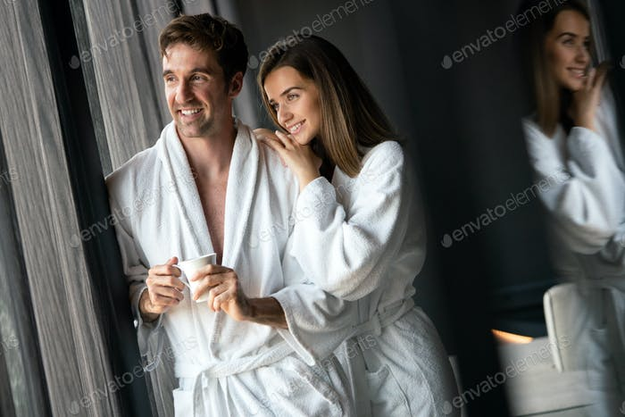 Couple in bathrobes enjoying honeymoon in spa resort