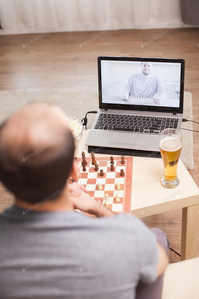 Smart men playing chess on video call