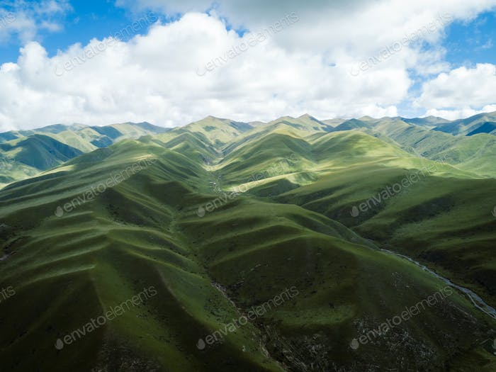 High altitude mountains with grassland landscape