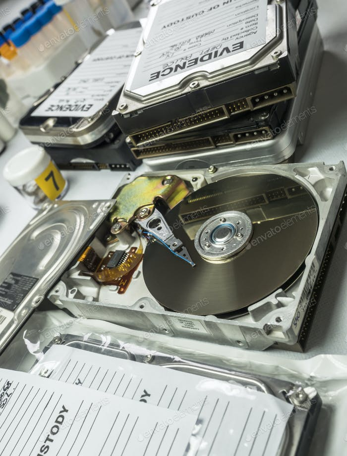 Hard drives in crime lab, concept image