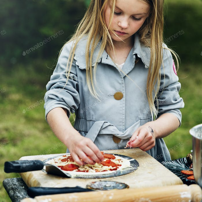 Small Girl Cooking Pizza Concept