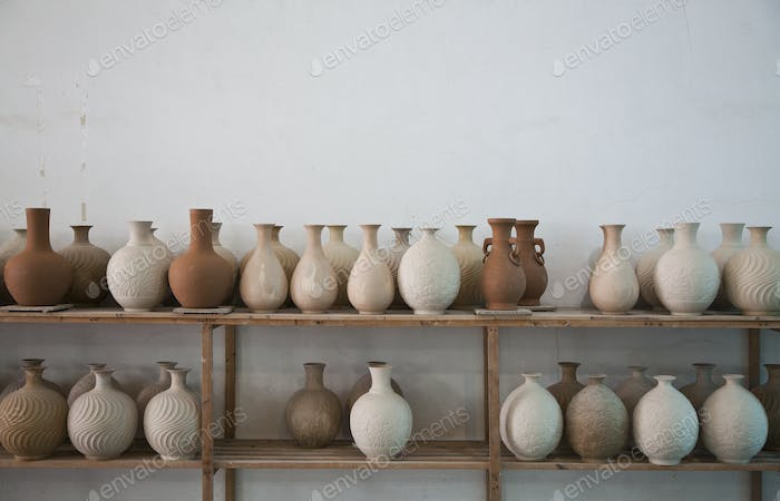45197,Clay Vases on Shelves