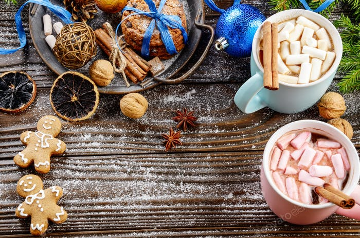 Flat lay Christmas background of two mugs of hot chocolate with