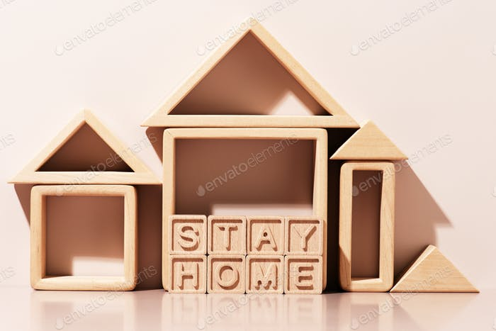 Stay Home Message of Wooden Letters and Abstract Wooden Houses