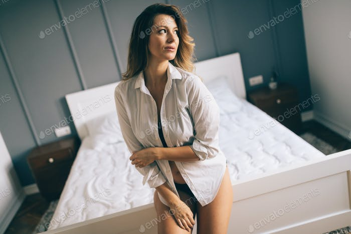 Picture of happy attractive woman in bedroom