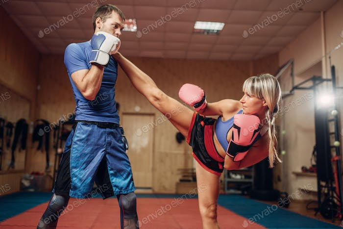 Female kickboxer with male personal trainer