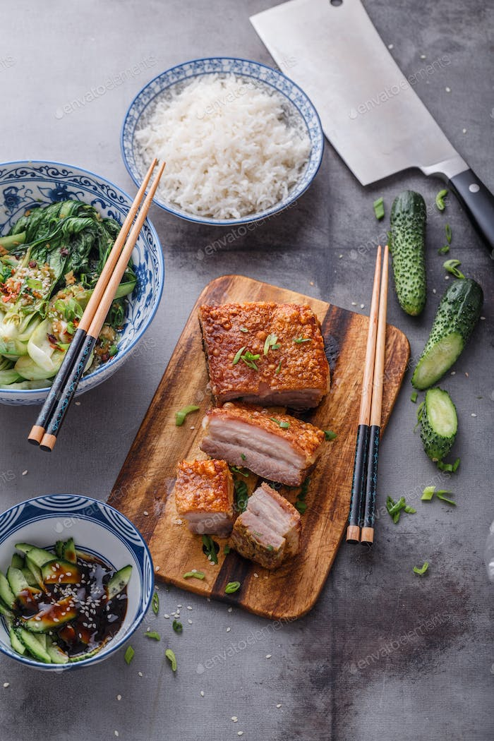 Chinese crispy skin pork belly with bok choy and cucmbers