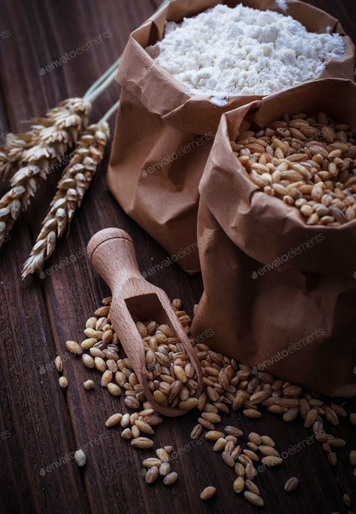 Wheat grain and flour in paper bags