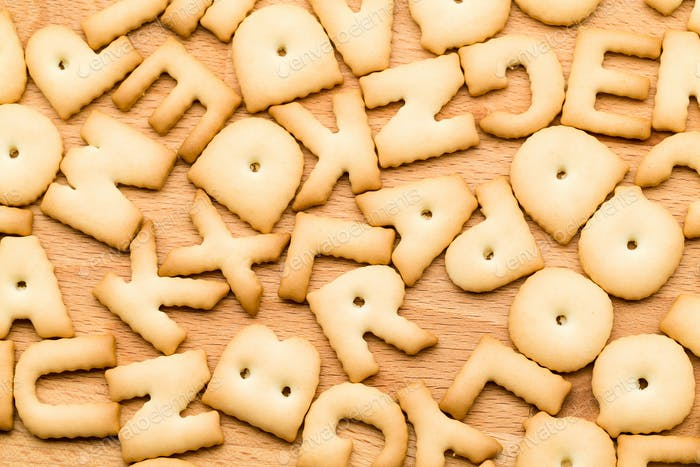 Baked word cookie over wooden table