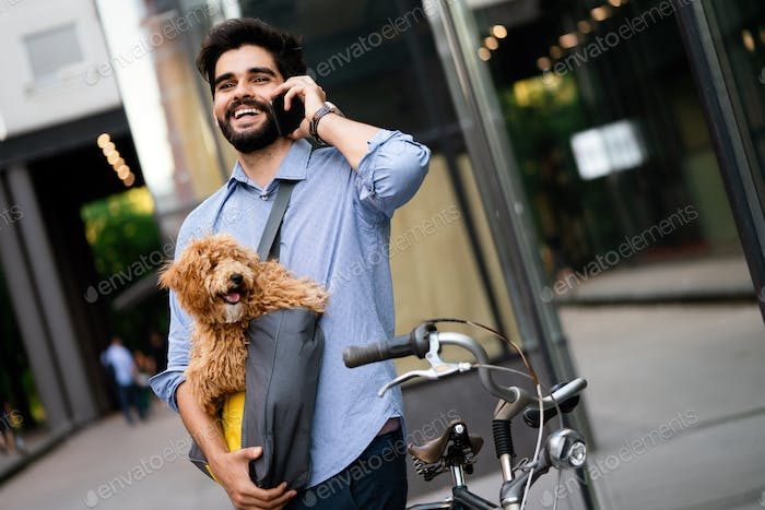 Lifestyle, transport, communication and people concept . Young man with bicycle and smartphone
