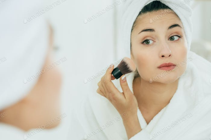 Woman in mirror bathroom making makeup, natural beauty female, beautiful model in bathroom