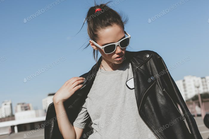 Girl posing against street