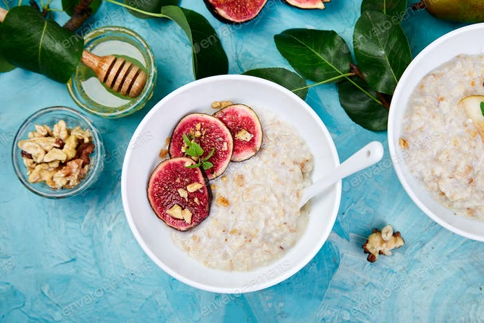 A bowl of porridge with pears slices and walnuts and porridge with figs