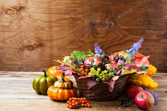 Fall wicker basket table centerpiece with blue flowers