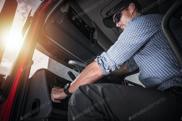 Semi Truck Driver Inside Vehicle Cabin