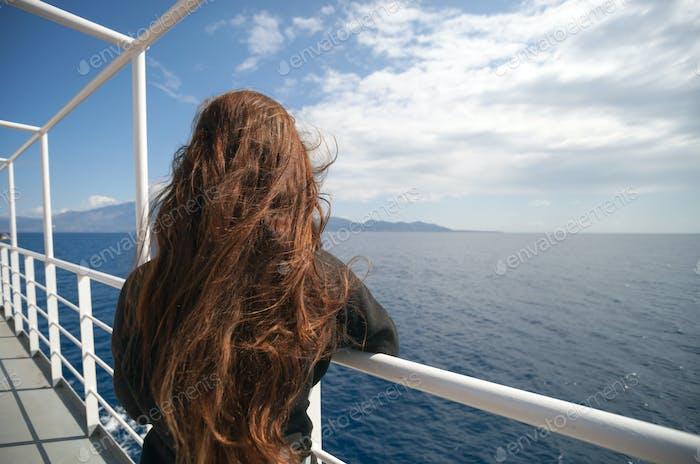 Passenger of cruise ship looking at sea
