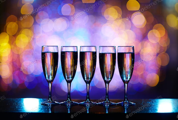 Line of flutes with champagne