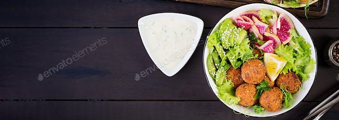 Falafel and fresh vegetables. Buddha bowl. Middle eastern or ara
