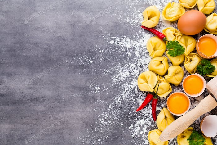 Raw homemade pasta,tortellini with herbs and egg.