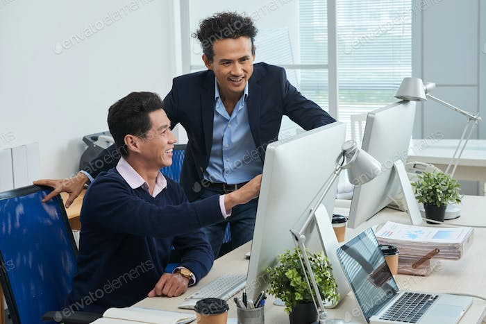 Businessman showing data to colleague
