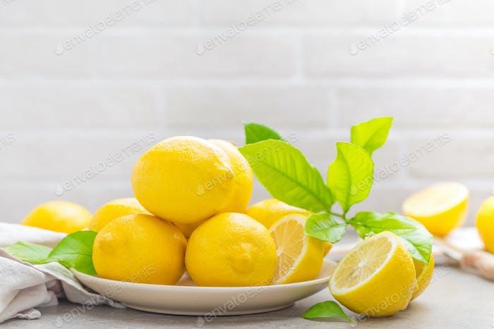 Fresh lemons with lemon leaves