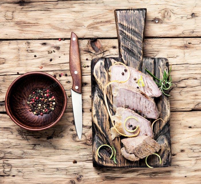 schnitzel on kitchen cutting board