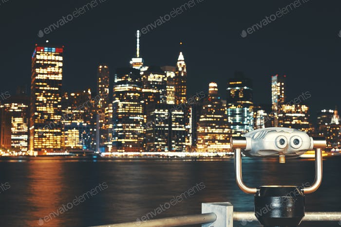 New Your City skyline with binoculars at night, USA.