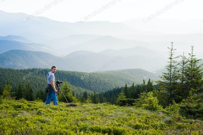 Professional photographer through the mountains.