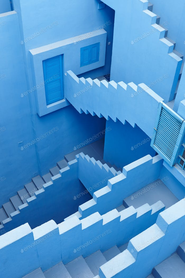 Geometric building stairs. The red wall, La manzanera. Calpe, Spain