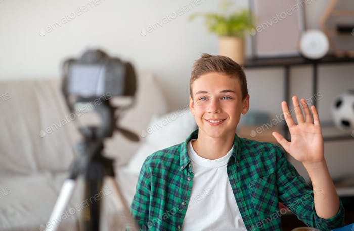 Teen blogger shooting video for his suscribers from home